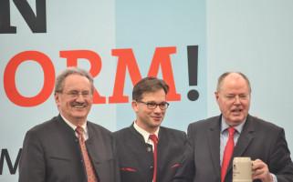 Sichtlich zufrieden: Christian Ude, Florian Pronold und Peer Steinbrück